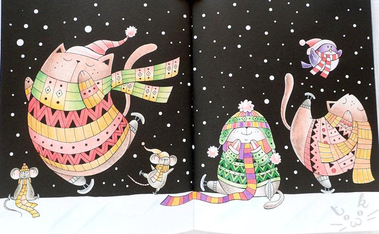 「 A Million Christmas Cats 」より、猫たちが気持ちよさそうに雪の中でスケートを楽しんでいる塗り絵