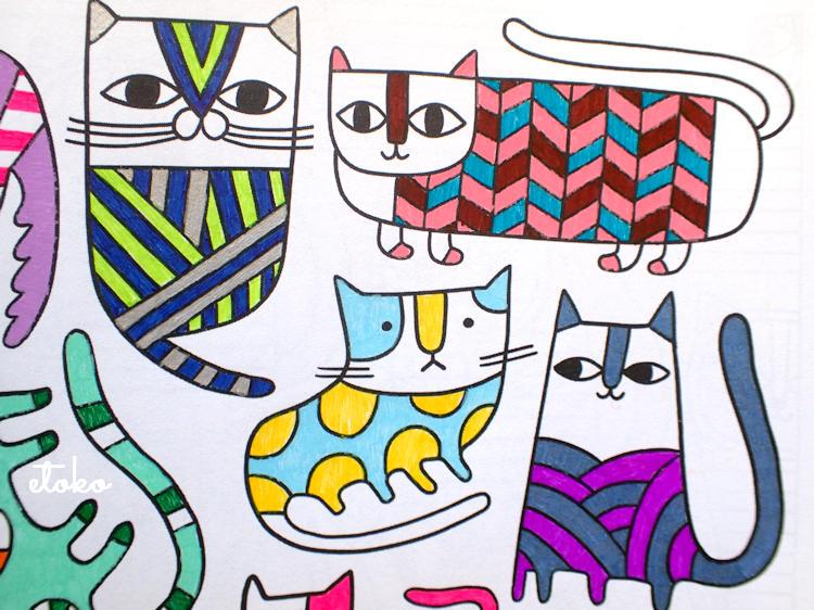 ゼブラのクリップとパイロットのジュースで塗られたレトロな雰囲気の猫の塗り絵