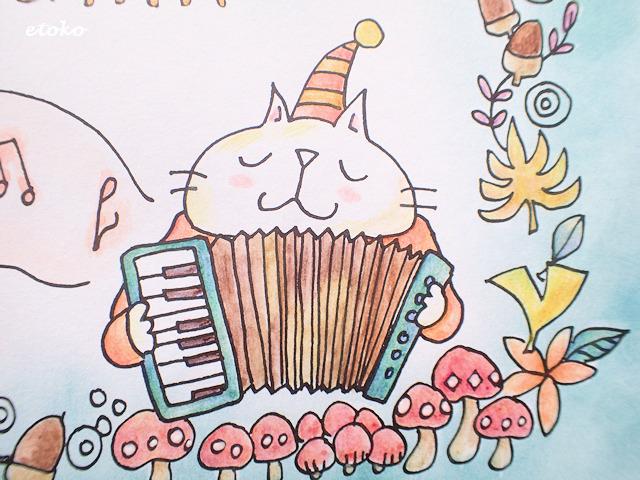 アコーディオンを奏でる猫