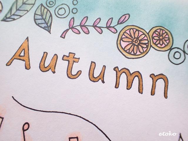 Autumnをブロンズカラーのゲルペンで塗っている