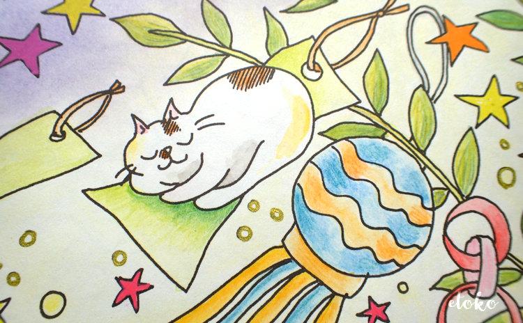 きまぐれ猫ちゃんズのミンミンが短冊の上で丸くなって寝ている