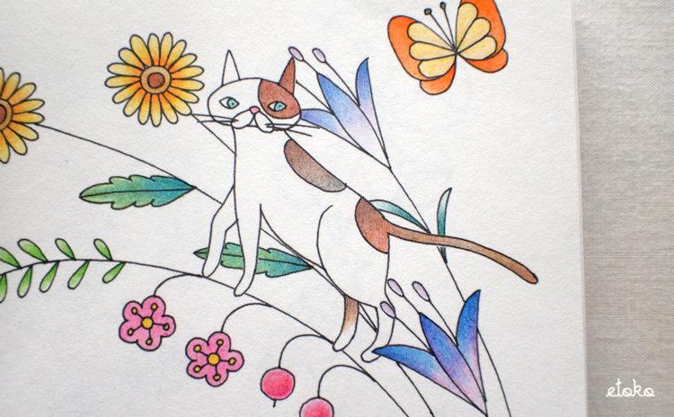 花々の間にひょっこり猫がいる線画