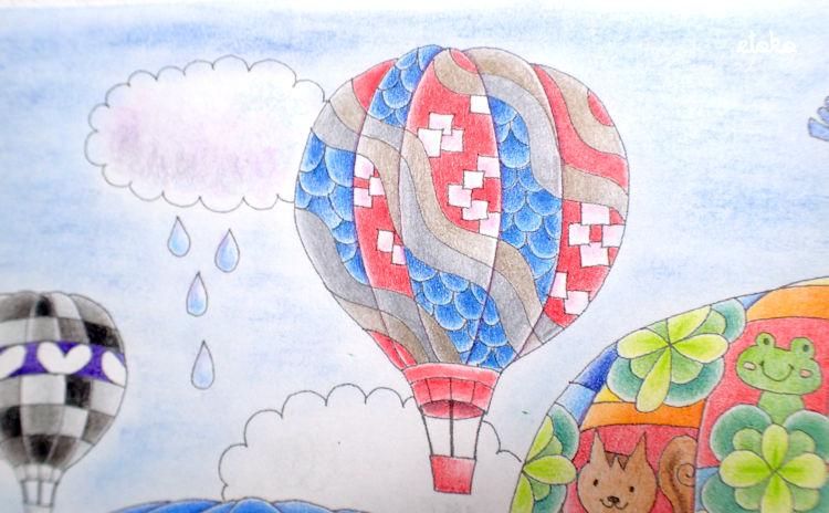 金銀の色鉛筆を主役に和風の気球を塗っている