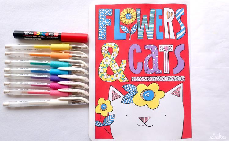 FLOWERS&CATSの文字と猫をポスカとゲルペンで塗っている