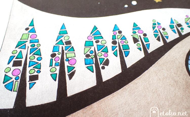 銀色の色鉛筆で背景を、ゲルペンで木を塗っている